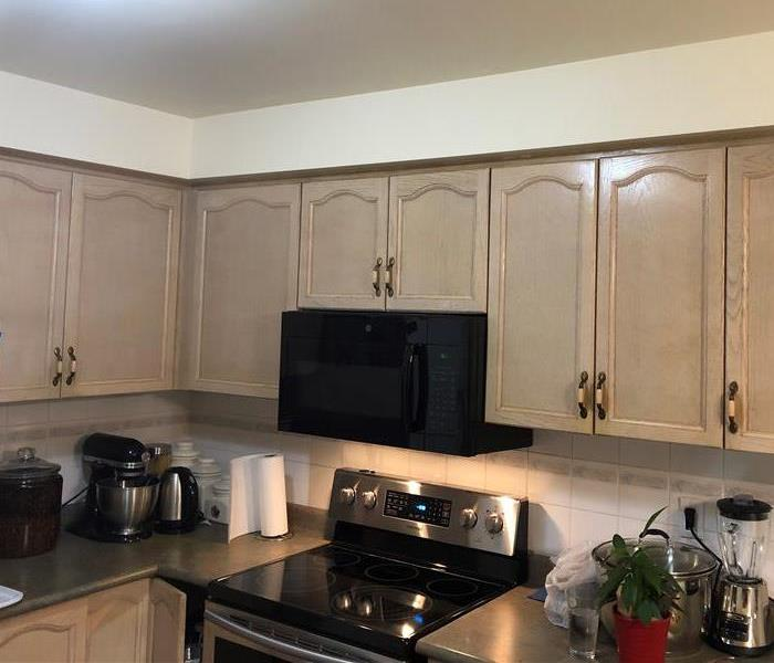 kitchen cabinets and countertops cleaned after black soot damage