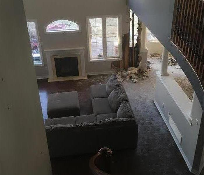 Family room with exposed framing from fire damage