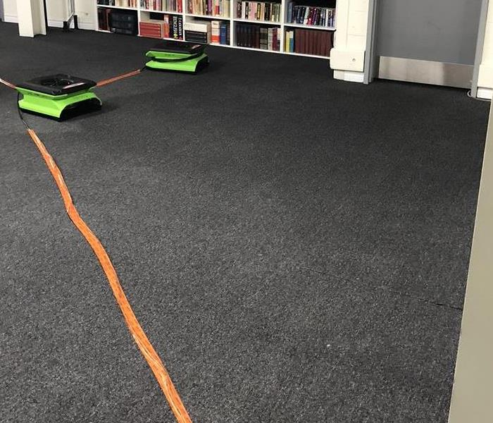 Dry commercial carpet with green drying equipment in place