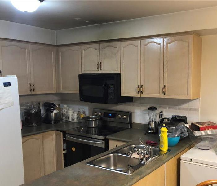 kitchen with soot on cabinets and ceiling