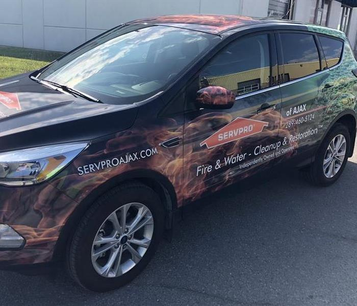SERVPRO ford escape wrap in SERVPRO colors
