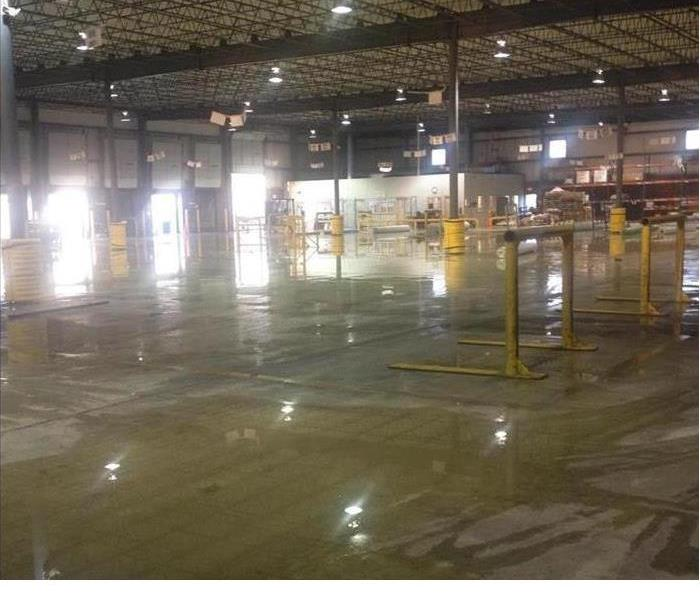 flooded warehouse with concrete floors and water standing