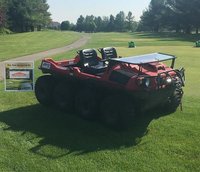 all terrain vehicle parked on golf course